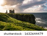 Coastal landscape of Northern Scotland with ruins of the Castle Sinclair Girnigoe, Near Wick at sunset.
