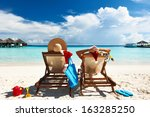 couple on a tropical beach at... | Shutterstock . vector #163285250