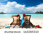 couple on a tropical beach at... | Shutterstock . vector #163285310