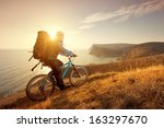 cyclist on a mountain bike... | Shutterstock . vector #163297670
