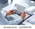 business person analyzing... | Shutterstock . vector #163300250