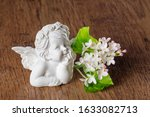A Sprig Of White Lilac And An...