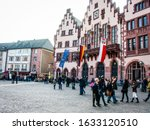 Small photo of Frankfurter Romer in Frankfurt Germany Europe with flags and tourists photographed on 2011.03.12