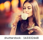 coffee. beautiful girl drinking ... | Shutterstock . vector #163332668