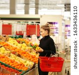Woman Buying Fruits At The...