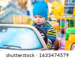 Little Baby Riding A Car In...