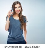 young woman posing on isolated... | Shutterstock . vector #163355384