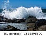 Waves Crashing Over The Rocks...
