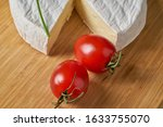 Cheese and tomatoes on wooden...