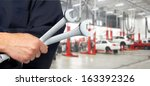 hand of professional auto... | Shutterstock . vector #163392326
