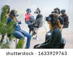 Small photo of A room with people immersed in virtual reality. Oculus rift Gear VR helmets - Moscow, Russia, 12 13 2019