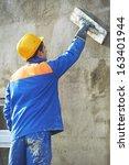 builder at facade plastering...   Shutterstock . vector #163401944