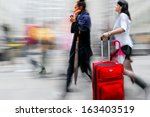 shopping in the city in motion... | Shutterstock . vector #163403519