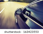 blurred road and car  speed... | Shutterstock . vector #163423553
