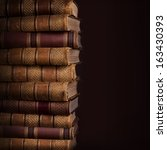 pile of ancient books on brown... | Shutterstock . vector #163430393