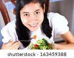 woman eating salad. portrait of ... | Shutterstock . vector #163459388