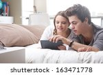 beautiful teenage couple using... | Shutterstock . vector #163471778