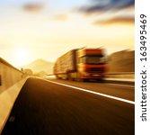 red truck on blurry asphalt...   Shutterstock . vector #163495469