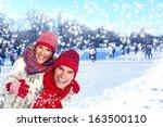 happy couple in winter clothing ... | Shutterstock . vector #163500110