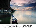Boat Under The Penang Bridge