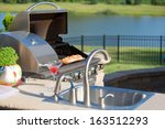 cooking salmon on the cedar... | Shutterstock . vector #163512293