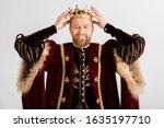 Smiling King Wearing Crown On...