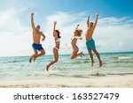 young happy friends have fun on ... | Shutterstock . vector #163527479