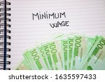 minimum wage handwriting  text... | Shutterstock . vector #1635597433