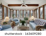 sunroom with wood ceiling beam... | Shutterstock . vector #163609280
