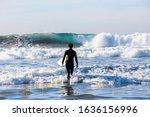 Surfer Boy Walking Into The Sea....