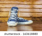 blue sneakers on the wooden... | Shutterstock . vector #163618880