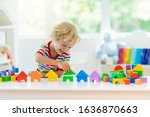 Kid Playing With Colorful Toy...