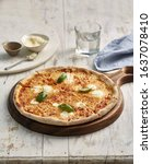 Small photo of Delicious Cheesy Pizza on Platter with Beautiful Background.