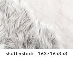Small photo of White fur for background or texture. Fuzzy white fur plaid. Shaggy blanket background. Fluffy fake textile fur. Flat lay, top view, copy space