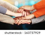 human hands on bright background | Shutterstock . vector #163737929