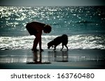 Stock photo boy and dog 163760480