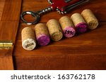 wine corks with corkscrew on... | Shutterstock . vector #163762178