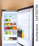 refrigerator full of food | Shutterstock . vector #163763744