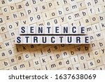 Small photo of Sentence structure word concept on cubes