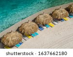 Beach Cabanas And Sun Loungers...