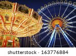 famous ferris wheel and old carousel at the oktoberfest in munich - germany - stock photo