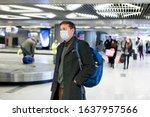 Young european man in gray coat ...