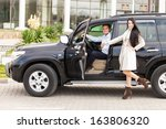 smiling couple and car | Shutterstock . vector #163806320