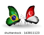 two butterflies with flags on... | Shutterstock . vector #163811123