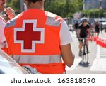 red cross of ambulance man on... | Shutterstock . vector #163818590