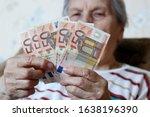 Elderly Woman Counts Euro...