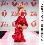 Small photo of New York, NY - February 5, 2020: Heather Graham wearing dress by Randi Rahm walks runway for The American Heart Association's Go Red For Women Red Dress Collection 2020 at Hammerstein Ballroom
