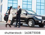 smiling couple and car | Shutterstock . vector #163875008