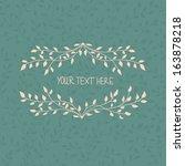 vector floral wreath   Shutterstock .eps vector #163878218