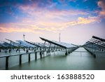 solar and wind power in sunset... | Shutterstock . vector #163888520